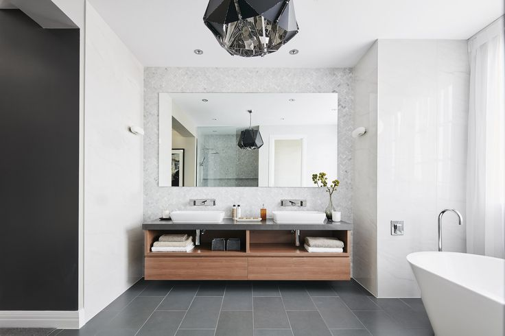 ENSUITE: The combination of architectural charcoal tiles, classical white marble and rich timbers amplifies the beauty of this bathroom and affirms its classic approach to design. Visit High Street on our Lookbook here: http://www.metricon.com.au/get-inspired/lookbook/high-street