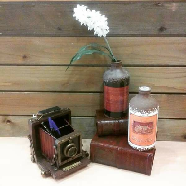 Vintage office decoration, camera books vases