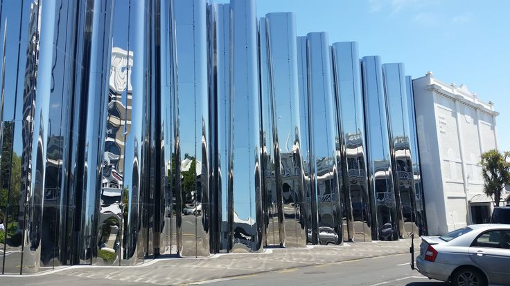 The Len Lye Centre and the the Govett-Brewster Art Gallery in New Plymouth. The Len Lye Centre is a new building (2015), the shimmering, iridescent colonnade façade, manufactured locally using stainless steel, and the first museum in New Zealand devoted to a single artist. The Govett-Brewster Art Gallery (right) opened on 22 February 1970, in what was then the unused Regent cinema building.