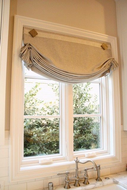 """Roman shade made from Robert Allen Serene Linen fabric with a 2"""" pleated border from Samuel & Sons. This combination of Sterling and Oyster colors fits right in with current kitchen design trends"""