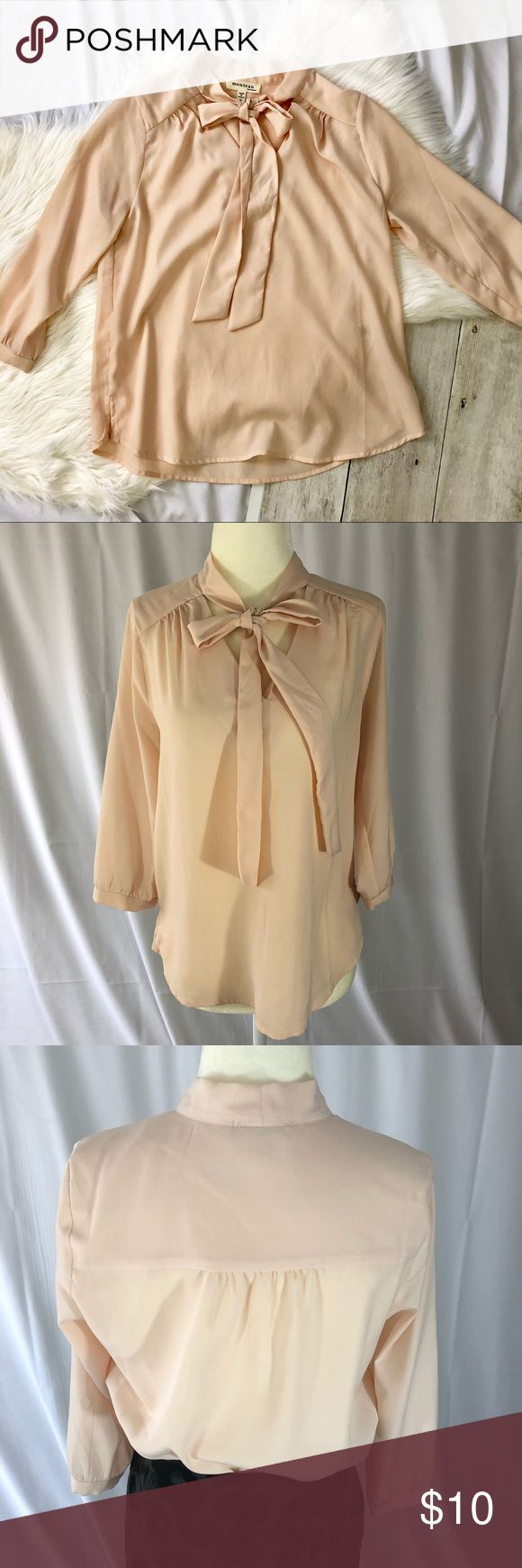Blush Blouse With Tie Front Detail - Size Small Blush Blouse. Boutique Brand Monteau. Shirt is V-neck but ties at the neck. Quarter Sleeves. Lightweight Material. Loose Fitting. Great for dressing up or business casual! Monteau Tops Blouses