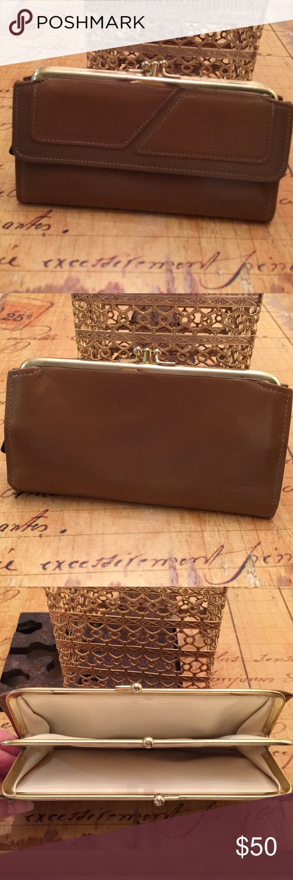"""🇺🇸 P Day Sale 🇺🇸 Vintage ROLFS Wallet Retro Brown ROLFS Genuine Cowhide wallet.  Clutch with 3 sections for change. Money/Checkbook slot with additional Zippered section. Original Charge card keeper.  Appears this has not even been used.   Some markings but this is due to being genuine cowhide leather.   Just over 7"""" wide; 4"""" tall; just under 1"""" deep Vintage Bags Wallets"""