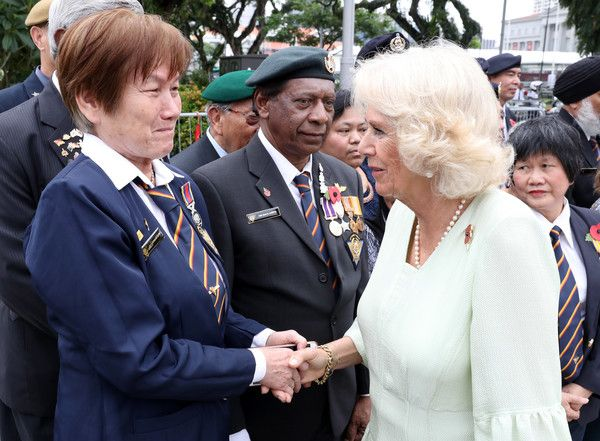 Camilla Parker Bowles Photos - Camilla, Duchess of Cornwall shakes hands with veterans after a memorial ceremony at The Cenotaph war memorial on October31, 2017 in Singapore. Prince Charles, Prince of Wales and Camilla, Duchess of Cornwall are on a tour of Singapore, Malaysia, Brunei and India. - The Prince Of Wales & Duchess Of Cornwall Visit Singapore, Malaysia, Brunei And India - Day 2