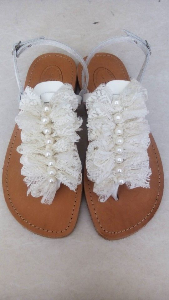 Handmade leather sandals with lace and pearls designed by Elli lyraraki