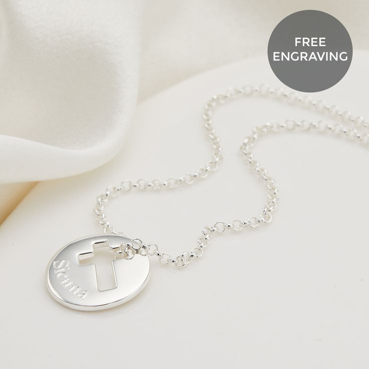 A contemporary sterling silver cut out cross disc pendant. Engrave with a name or date to commemorate a special moment in her life. Perfect for Christenings or Holy Communion.