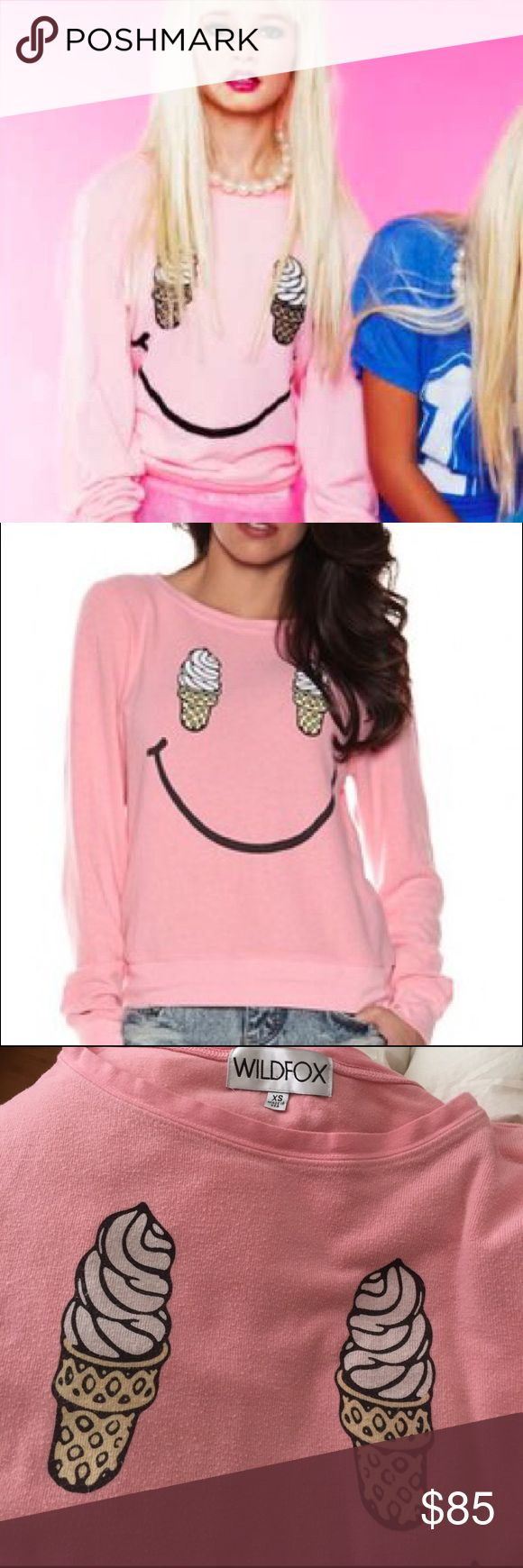 Wildfox Soft Serve Smile Ice Cream Jumper Sweater This is a Wildfox soft serve 🍦 smile ice cream jumper. Pink crew neck long sleeve. Made of rayon and polyester. Size extra small. Oversized fit. Mint condition and sold out everywhere. Wildfox Sweaters Crew & Scoop Necks