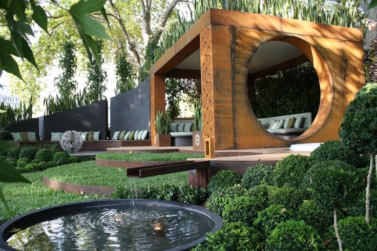 Conversation | Garden designed by Paal Grant. Structural steel beams within the design are Boxspan steel beams by Spantec.