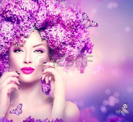 acconciature: Bellezza moda modello ragazza con fiori lilla acconciatura Archivio Fotografico