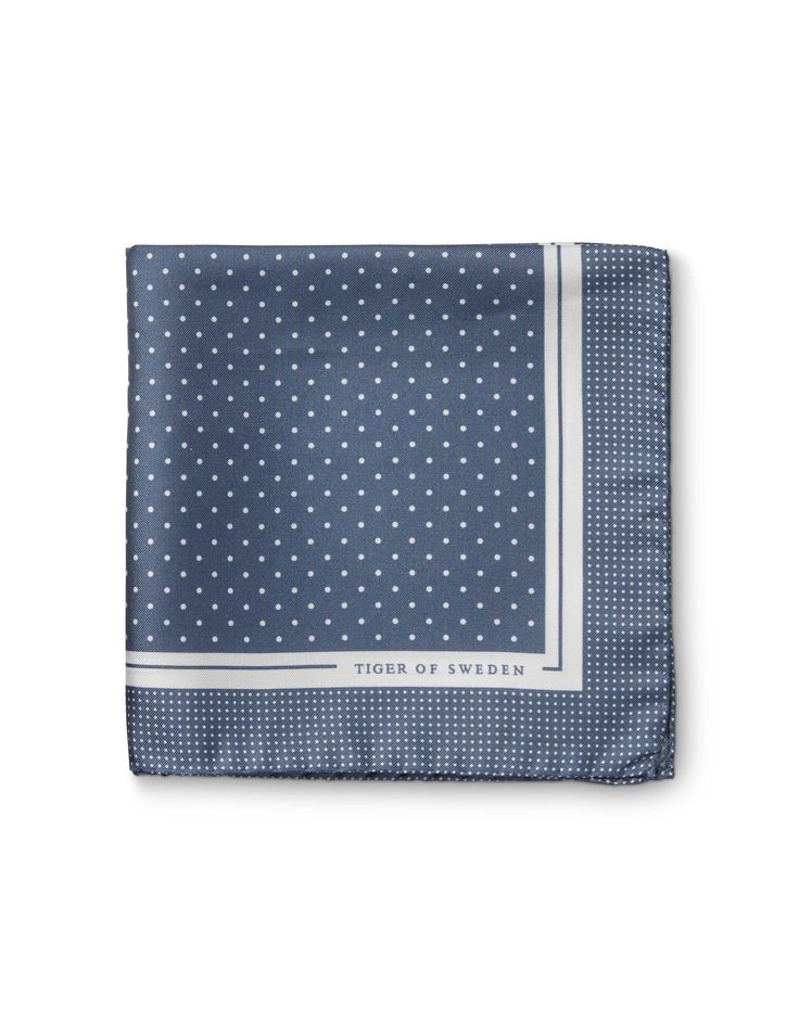 Puntilli handkerchief - Men's handkerchief in pure silk twill. Features all-over printed polka dot pattern. White border with Tiger of Sweden logo in one corner.