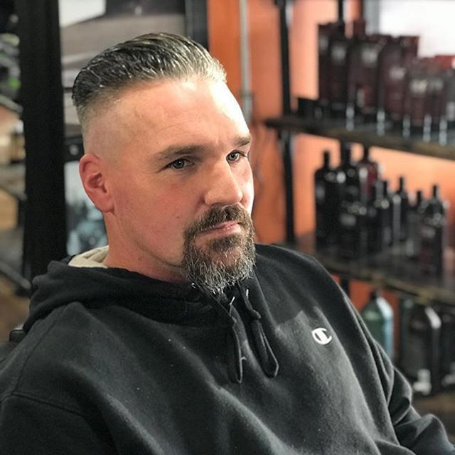 This skin fade that is long on top with goatee looks great!     Start your new year with a new look! Get into your Hair Mechanix and try a new look! #Repost @hairmxwestland  ・・・  New year new me 🙌👌🏼💈 #hairmx #illcutyou #ladybarber #menscuts #faded #michigan #baberlove #lineup #newyou #allabouthair #taper #love #instagood #2018 #newyearnewme #mensfashion  #newyearnewyou #backtowork