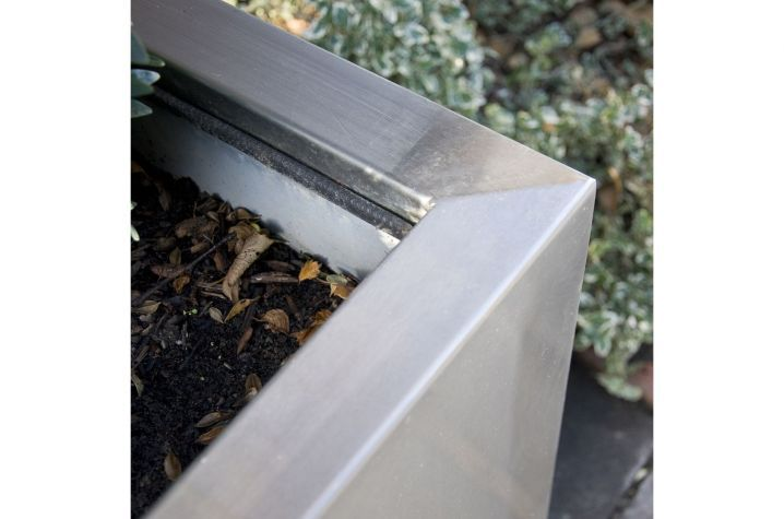 Detail showing inner liner, outer planter and galvanic isolation in design for Garryard House planters