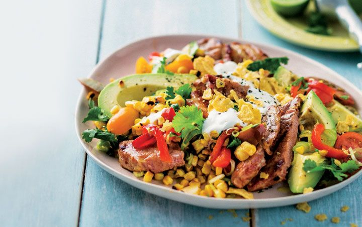 Gammon steaks with corn and avo salad