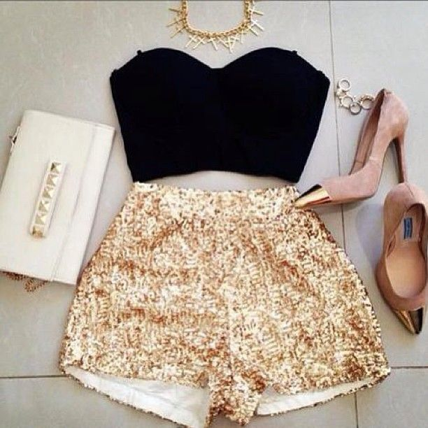 Sparkle shorts, cropped black top, spiked necklace & metallic capped heels. Dream come true in an outfit