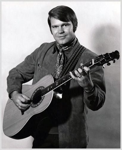 Glen Campbell holding one of the guitars he frequently enjoyed making memorable tunes with.