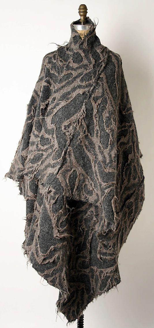 Issey Miyake felted cape. (Japanese, born 1938) Design House: Miyake Design Studio (Japanese) Date: ca. 1983 Culture: Japanese Medium: wool, acrylic, other blend.