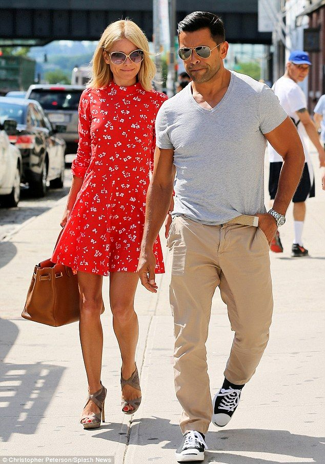 Happy dress! TV personality Kelly Ripa wore a delightful red summer dress for a trip to the hair salon with husband Mark Consuelos Monday in New York