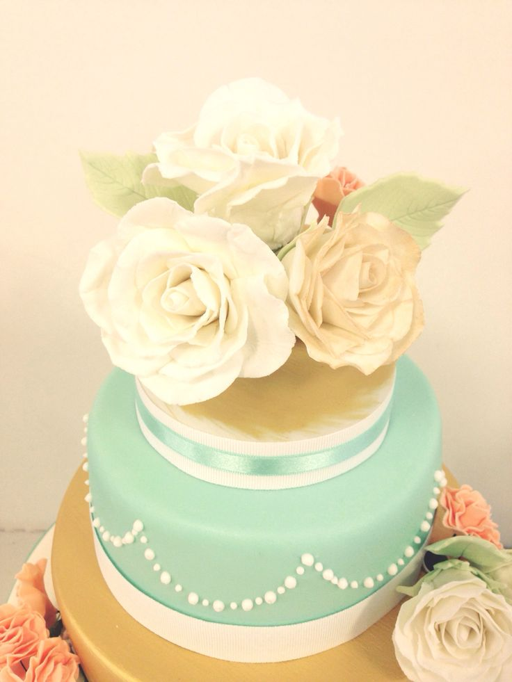 Brushed gold, three tiered wedding cake with sugar flowers