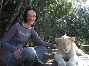 me and Mkulu in Port Elizabeth on holiday. My furry friend is a young white lion, he was only a baby but heavy enough to hurt if he wanted to, he was sleepy while I was there and really enjoyed being scratched on the neck