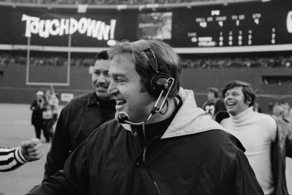 1972 — Pittsburgh Steelers' coach Chuck Noll beams after Franco Harris scored the winning touchdown against Oakland to win 13 to 7. On the play, Steelers' Terry Bradshaw passed to Frenchie Faqua. Faqua and Oakland Raider Jack Tatum collided and the ball bounced to Franco Harris. Tatum denied he touched the ball but the official ruled he did.American Football Playoffs — Image by © Bettmann/Corbis    -