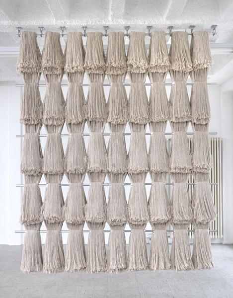 Kentucky (Divider), 2011. mop heads,   metal rods, and hooks, by Alexandre da Cunha