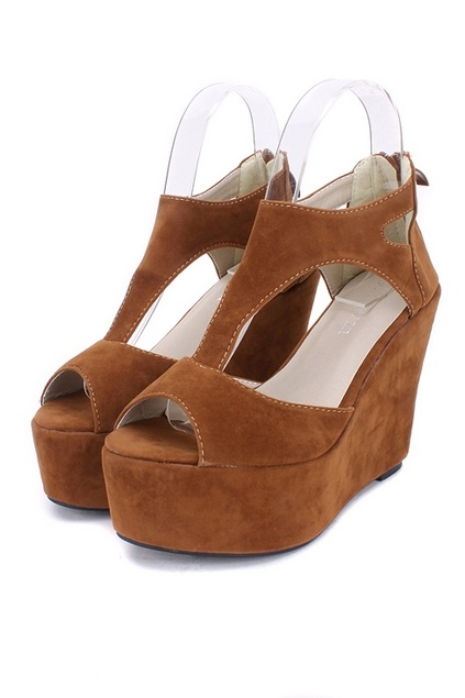 The wedges crafted in suede and rubber, featuring peep toe, t-bar vamp with cut-out detailing, a zip fastening to the reverse, high platform and wedge.$32