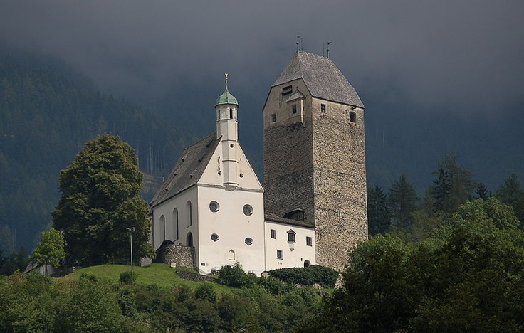 Schloss Freundsberg  Tirol, Austria. This was the view from my apartment while living in the Inn valley. The tower is the older part of the structure and houses a museum. The church was added later. It's worth the visit and the attached restaurant offers wonderful refreshments.