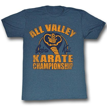 This is an authentic All Valley Karate Kid cotton blend adult tee shirt in  blue with yellow lettering on front.