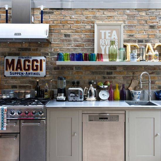 Modern rustic industrial kitchen. Rough brick wall with an gray open shelving, with colourful glassware, the metal also adds a modern edge to a traditional look. Stainless steel furnishings help to highlight the exposed brick wall and bring out the warmth of the colours - I think I found my kitchen