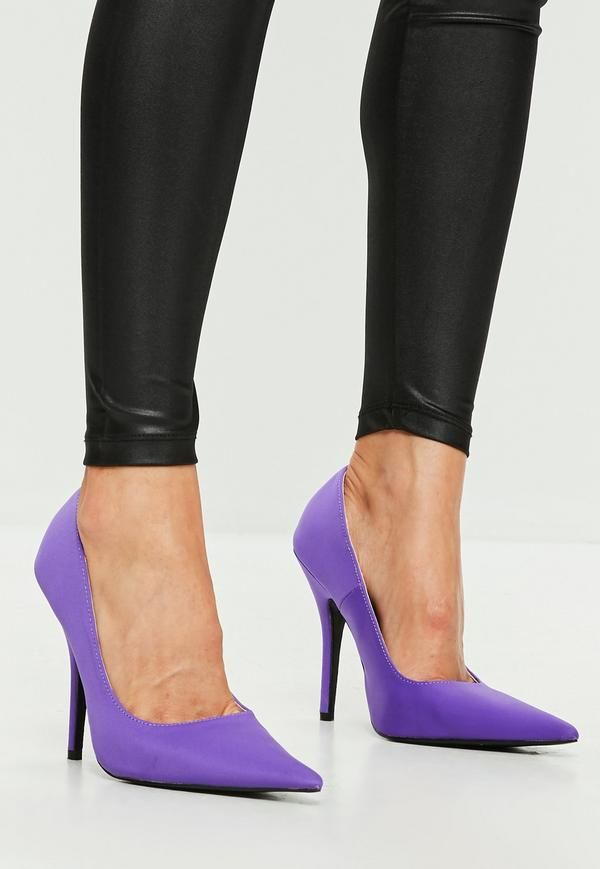 These purple court shoes feature an extreme pointed toe, stiletto heel and neoprene fabric.