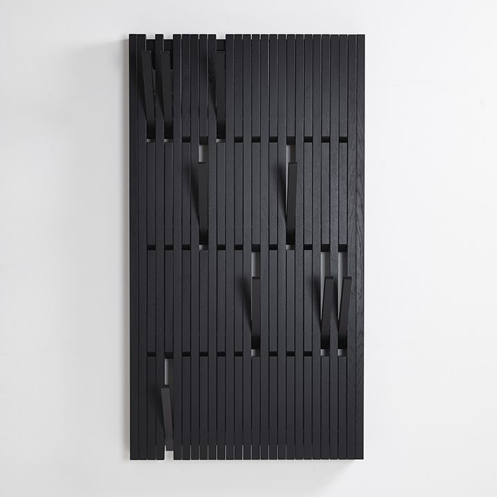 Piano coat rack by by Patrick Séha for Per/Use. This multi-purpose coat rack and hanger panel has foldable hooks, taking up virtually no space unless needed.