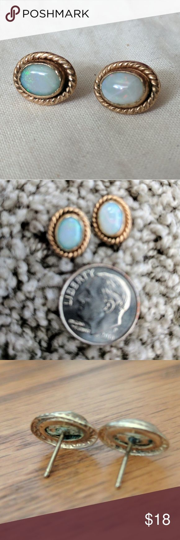 Vintage opal stud earrings I believe these are set in gold but not certain.  Found in a relative's home. There are so.e imperfections in the stones but still very pretty.  Backs are missing but I will provide plastic backers.  Backs show some tarnish.  Selling these for a good price because I am not certain of their value. Vintage Jewelry Earrings