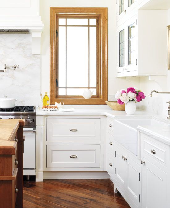 Raw wood trim can be pretty when everything else is white.