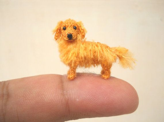 The micro mini Golden Retriever is crocheted only by embroidery threads, micro sewn black cored plastic eyes and stuffed by polyfil.    Size : Aprox. 1.2