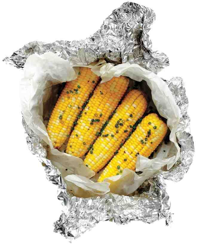 Grilling corn in foil packets seals in moisture for a tasty, tender side hot off the fire  -- and you won't have to wash a single dish.