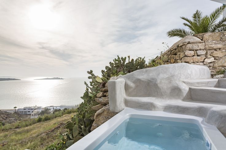 Panoramic views of a unique sunset to the island of Delos and the Aegean Sea, whilst soaking in the outdoor Jacuzzi of the Bohemian Sea View Suite! Pure moments of luxury & relaxation.
