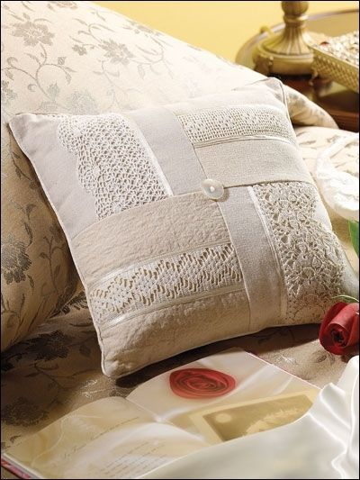 "Pillow inspiration, no instructions. I am going to crochet some edgings and cut strips of nice fabric, then put them together for a 14"" pillow form. Nice wedding gift."