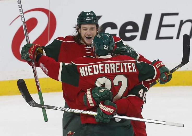 New guy makes good:    Ryan White, top, skates in to celebrate a goal by Wild teammate Nino Niederreiter against the Kings in the first period Feb. 27 in St. Paul,  Minn. White, playing his first game for Minnesota after being obtained from Phoenix in a trade, recorded an assist on the goal.