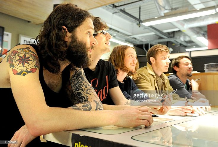 Scott Miller, Jon Warren, Peter Liddle, Matthew Taylor and Will Harvey of Dry The River sign their album 'Shallow Bed' for fans after performing at Fopp on March 9, 2012 in Manchester, England.