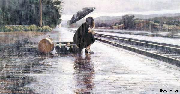 Sous la pluie, sur le quai de la gare...
