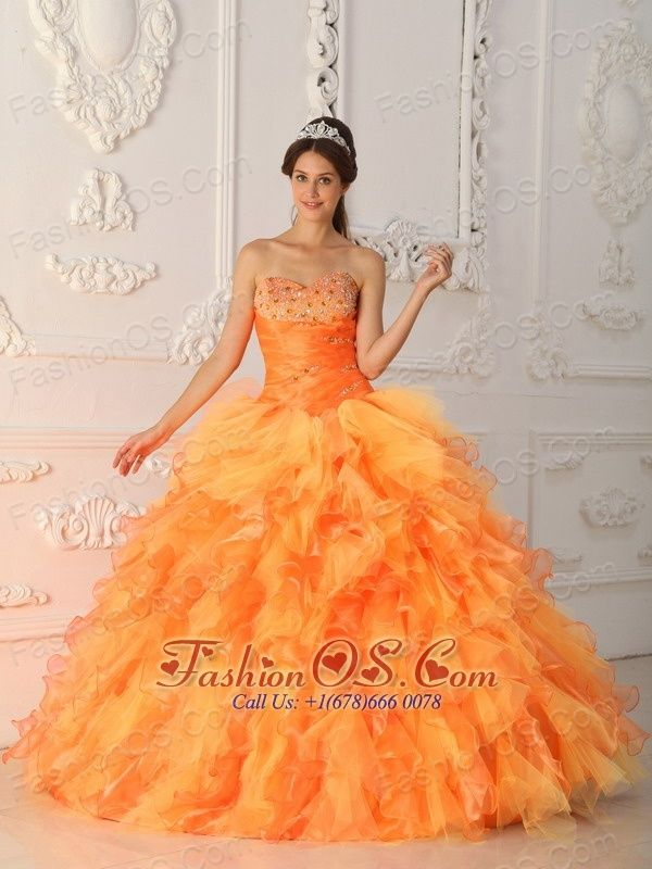Elegant Orange Red Quinceanera Dress Sweetheart Organza Beading and Ruch Ball Gown  http://www.fashionos.com  The sweetheart neckline quinceanera dress with a fully beaded bust features a ruching bodice. The bubbled ball gown is made from layers of rufels, which add to its beauty, fullness and lovely shape. This is a fantastic choice for someone wanting something a little different for their special occasion.