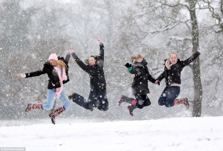 Teenage girls celebrate in the snow in their wellington boots after their school was closed in the South West due to the blizzards