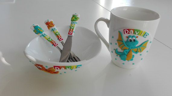 """Dragon,Children,Children's cutlery,Children's Gift,Custom Order,,Personalized Cutlery,Gift for Birthday,Cutlery Cup and Bowl Child's set    Cutlery sets contain :  Cutlery Cup and Bowl  .....  Dimension baby/toddler spoon is 15 cm (6,1"""") 0-3y  Dimension children spoon is 17 cm (6,7"""")4-10y    I custom make any words or names you desire provided the word is no longer than 8- 9 letters on one side, in any color you request.    Email me with your request and names/words needed and I will make a…"""