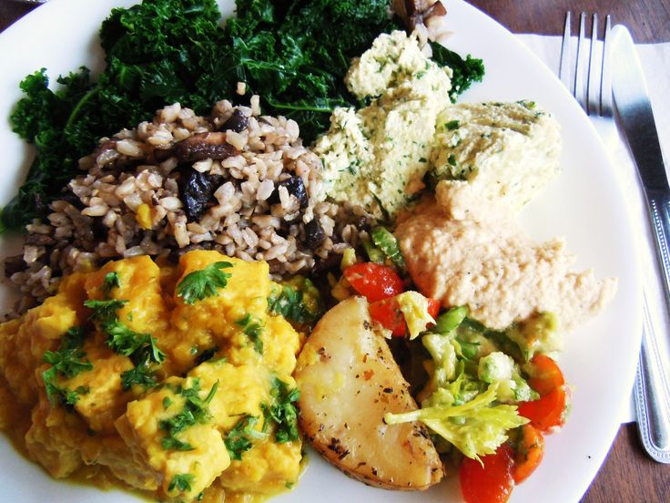 """A plate of delicious vegetarian and vegan goodness from Kale by Yonge & Eglinton in Toronto!  Steamed kale, portobello brown rice, spinach """"pie"""", roasted potatoes, hummus, lentil curry stew and more."""