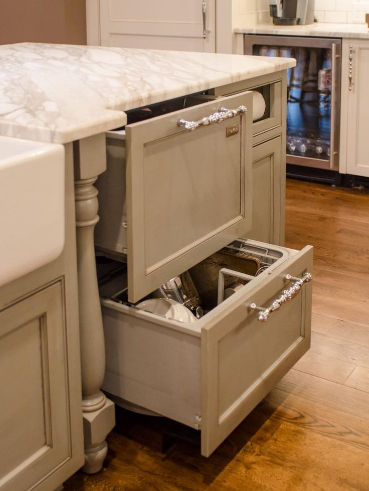 "The double-drawer dishwasher is also housed in the kitchen island. ""Consider your daily activities; locate the dishes you use every day close to the dishwasher. You don't want to put dishwasher on the left side of the island if your everyday dishes are on the right side of the wall,"" advises McGilvray.  ""Also, it sounds simple, but people don't always consider how appliances line up, like making sure the dishwasher isn't across from the oven."""