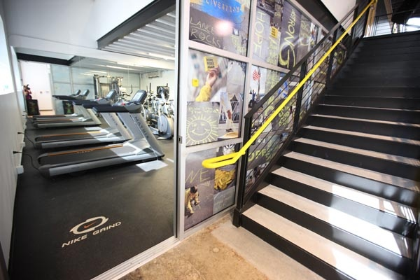 Everlast in the workout area of the Lance Armstrong Foundation. Rubber Gym & Weight Room Flooring: Recycled & Sustainable Rubber Tiles & Gym Flooring   Reuse-A-Shoe & Nike Grind ECORE Commercial Flooring recycled rubber