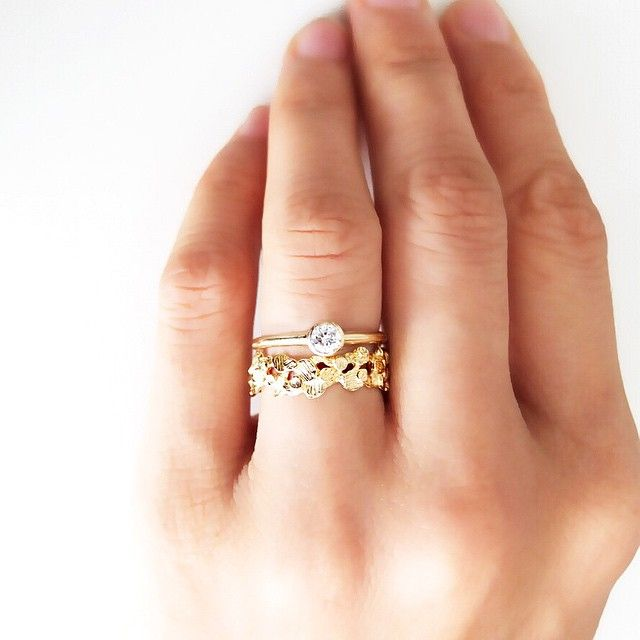Pin for Later: 34 Creative Ways to Style Your Wedding Band Who Said Your Band Had to Be the Smallest Ring on Your Finger?