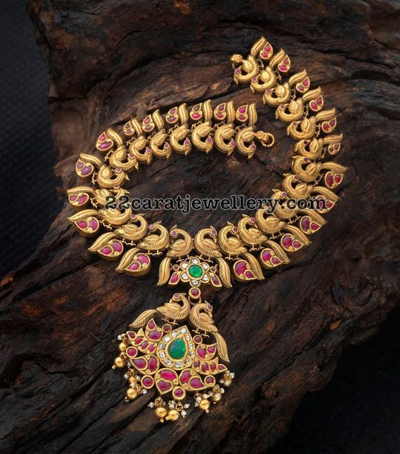 Antique finish peacock mango necklace with cabochon rubies and classic work designer pendant, Studded with emeralds, rubies and diamonds. ...