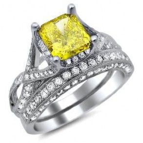 Fancy Yellow Cushion Cut Diamond Engagement Ring Bridal Set - If we had to put two pieces together that matches perfectly it would be this 18k White Gold Fancy Yellow Cushion Cut Diamond Engagement Ring Bridal Set in a Pave & Prong setting with a Yellow Cushion center stone with White Round accent stones. The Fancy Yellow Cushion Cut engagement set comes with an SI1 & VS2 in clarity & an E – F in color. The weight is equal to 2.60 carats & the diamonds are 100% natural…