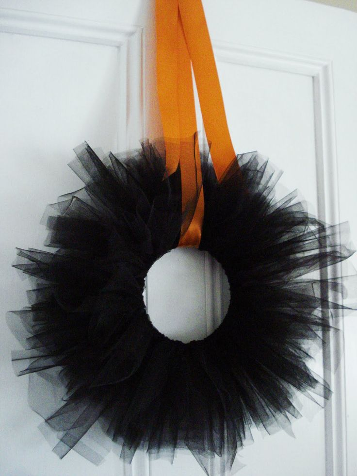 Tulle and ribbon wreath.  Note to self - make this in orange for Halloween.