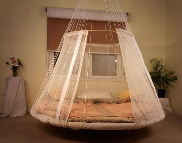 round bed hanging from ceiling. I think this is made from an recycled trampoline. Fun.